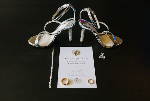 bride shoes and rings detail shot